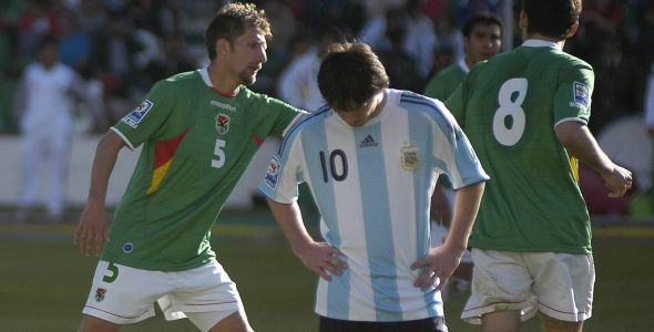 Argentina's Lionel Messi reacts as Bolivia's Ronald Rivero (L) and Ronald Garcia (R) celebrate a goal during their 2010 World Cup qualifying soccer match in La Paz April 1, 2009. REUTERS/Daniel Caballero (BOLIVIA SPORT SOCCER)